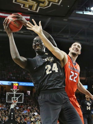 Central Florida center Tacko Fall (24) battles with Illinois center Maverick Morgan (22) for a rebound during an NCAA college basketball game of the NIT in Orlando, Fla., Wednesday, March 22, 2017. (Stephen M. Dowell/Orlando Sentinel via AP)