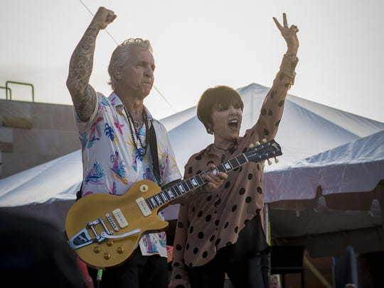 Pat Benatar and long-time partner Neil Giraldo perform