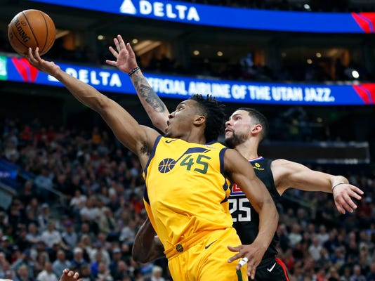 Utah Jazz guard Donovan Mitchell (45) goes to the basket as Los Angeles Clippers guard Austin Rivers (25) defends in the second half during an NBA basketball game Thursday, April 5, 2018, in Salt Lake City. (AP Photo/Rick Bowmer)