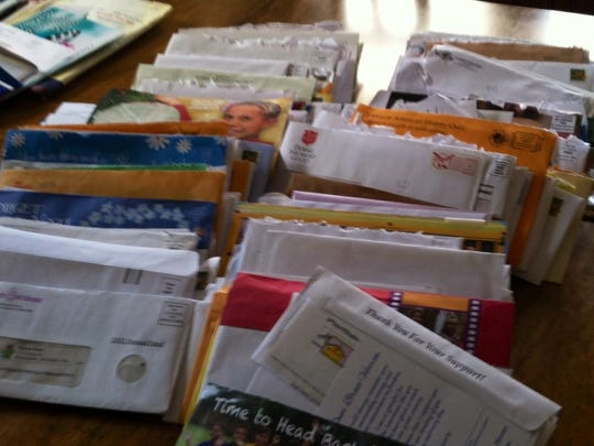 Birmingham resident Marion Beck collected over 300 pieces of unsolicited mail over a one-year period.