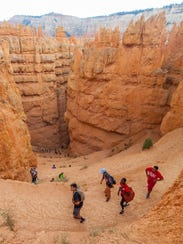 Southern Utah University students and tourists hike