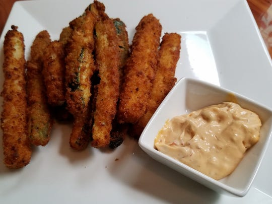 Banyan 320 Kitchen and Bar's zucchini fries were a mountain of hand cut, freshly breaded and fried zucchini strips with a Chipotle aioli.