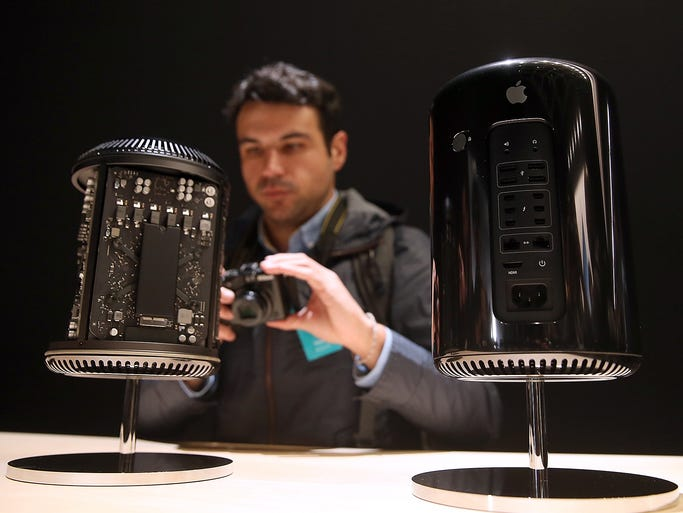 A person looks at the new Mac Pro during an Apple event at the Yerba Buena Center for the Arts on Oct. 22, 2013, in San Francisco, California. Thirty years ago Apple's Macintosh computer shattered the conventional notions of what a computer should be.