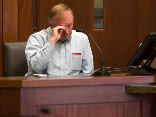 Lorin Holm, an exiled member of the Fundamentalist Church of Jesus Christ of Latter Day Saints, wipes away a tear as he describes his hopes for the future of his family during a child custody hearing between Holm and his two ex-wives, who still belong to the FLDS Church, in St. George's 5th District Court in 2014.