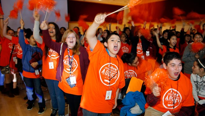Sixth-grade students cheer during the first New Mexico Young Achievers Forum, hosted by NMSU at Corbett Center.