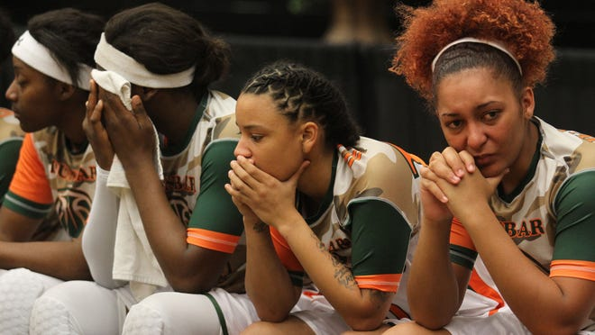 Dunbar's Alicia Johnson, right, along with other Lady Tigers react after losing to Lake Highland Prep during the Class 4A state championship game at the Lakeland Center.