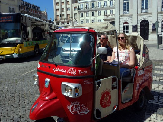 Little tuk-tuks are a fun way to sightsee around Lisbon.