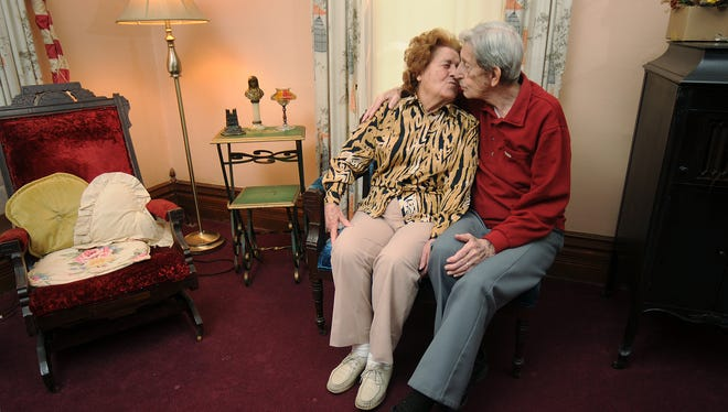 Lester Rentmeester and his late wife, Jeanne, share a kiss on April 9, 2009, in the parlor of their home that was built in 1826.