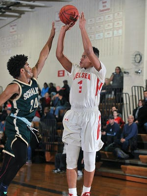 Kaleb Morton of Delsea goes up for a shot over Schalick's Taylor Clarke during action this season.