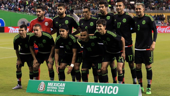 Mexico players pose for a group photo before a game against Senegal during a soccer friendly at Marlins Park.