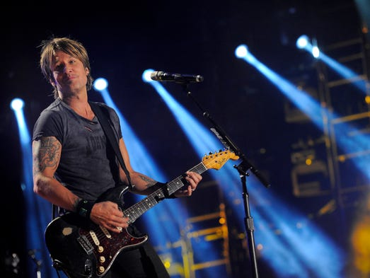 Keith Urban performs at CMA Fest at LP Field Saturday June 7, 2014, in Nashville, TN.