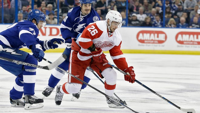Red Wings right wing Tomas Jurco (26) skates around Lightning defenseman Victor Hedman (77) and center Brian Boyle (11) during the first period Wednesday in Tampa.