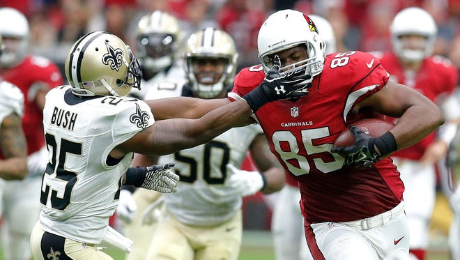 Arizona Cardinals tight end Darren Fells (85) runs as New Orleans Saints free safety Rafael Bush (25) pursue during the first half of an NFL football game Sunday in Glendale, Arizona.