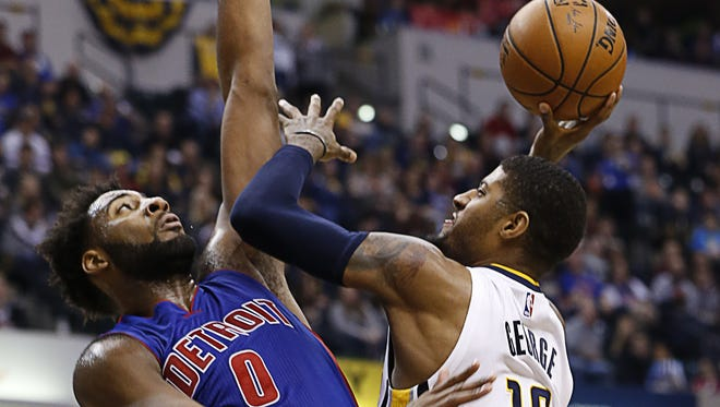 Indiana Pacers forward Paul George (13) works Detroit Pistons center Andre Drummond (0) down low at Bankers Life Fieldhouse on Jan. 2, 2016.