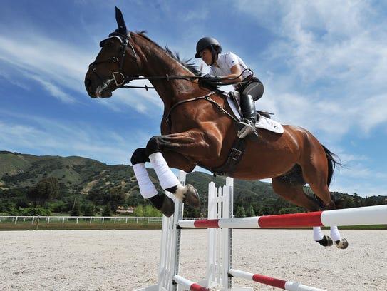Visalia-native Lauren Billys and her Irish sport horse