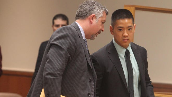 James Nobles talks with Charles Tan after the ruling.