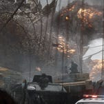 """""""Godzilla."""" crunches everything in its path in this reimagining of the classic Japanese monster."""