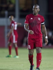 Didier Drogba walks down the field during a stoppage
