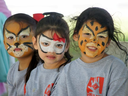 From left are Jocelyn Lobato, Liliana Bracamontes and Nadia Perez, a collection of face-painted kitties.
