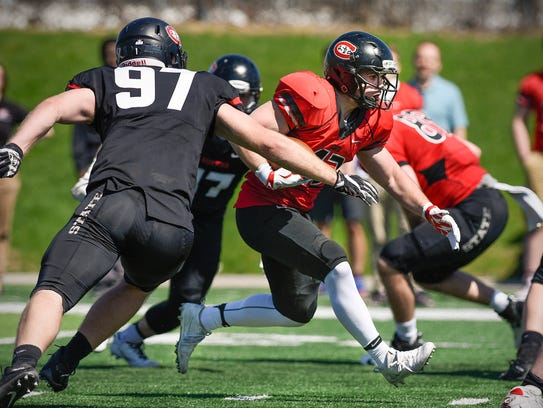 St. Cloud State running back Matt Winters breaks through
