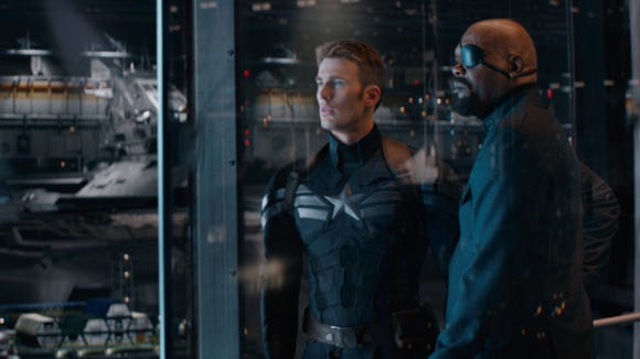 "Cap (Chris Evans) and Nick Fury (Samuel L. Jackson) are at the center of a big ol' conspiracy in ""Captain America: The Winter Soldier."""