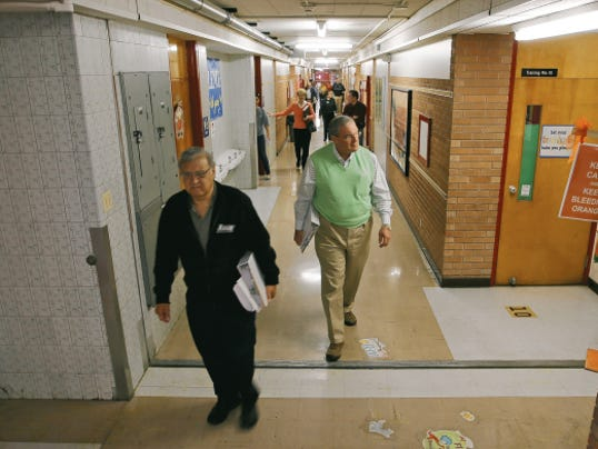 VICTOR CALZADA-EL PASO TIMES Ed Archuleta, left, and Dee Margo walked a hall at Beall Elementary School as they, other members of the district's Board of Managers and other district personnel toured the school Monday.