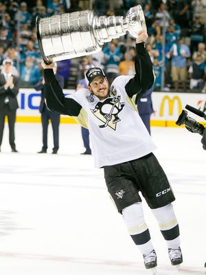 June 12, 2016: Pittsburgh Penguins center Sidney Crosby (87) hoists the Stanley Cup after the NHL Stanley Cup Finals game 6 between the Pittsburg Penguins and the San Jose Sharks at the SAP Center in San Jose, CA. The Penguins defeated the Sharks 3-1. Damon Tarver/Cal Sport Media (Cal Sport Media via AP Images)