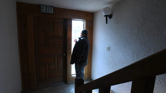 Bob Ramsey of Ramsey Realty looks out the window of a building at 119 E. Chuska St. in Aztec on Dec. 16 where a new business incubator will be located.