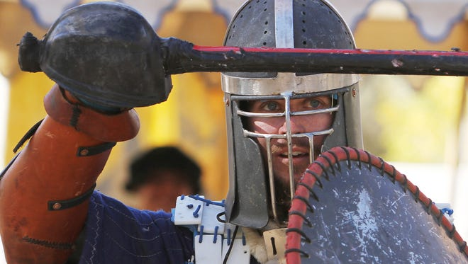 Ted Newcomb engages in a battle Oct. 20, 2012, during the Renaissance Faire at Animas Park in Farmington.