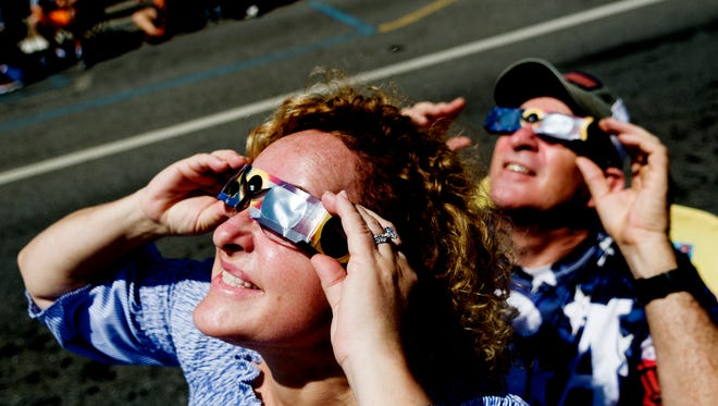 Elizabeth and Ron Stagg, of Sweetwater, Tennessee, watch the solar eclipse during the total solar eclipse festival in Sweetwater, Tennessee on Monday, August 21, 2017. Sweetwater is expected to experience over two minutes of complete totality.