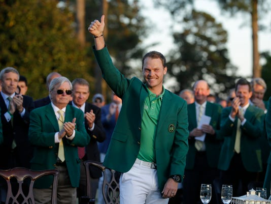 Masters champion Danny Willett, of England, gives a thumbs up after winning the Masters golf tournament Sunday, April 10, 2016, in Augusta, Ga.  (AP Photo/Chris Carlson)