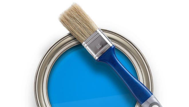 High angle view of blue paint can with brush isolated on white background