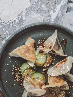"""Pan-fried Pork and Kimchi Dumplings from """"This Is a Book about Dumplings"""" by Brendan Pang."""