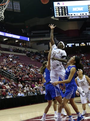 FSU's Shakayla Thomas puts up a shot during the Noles' 86-65 loss to the Buffalo Bulls in the second round of the NCAA Tournament at the Tucker Civic Center Monday.