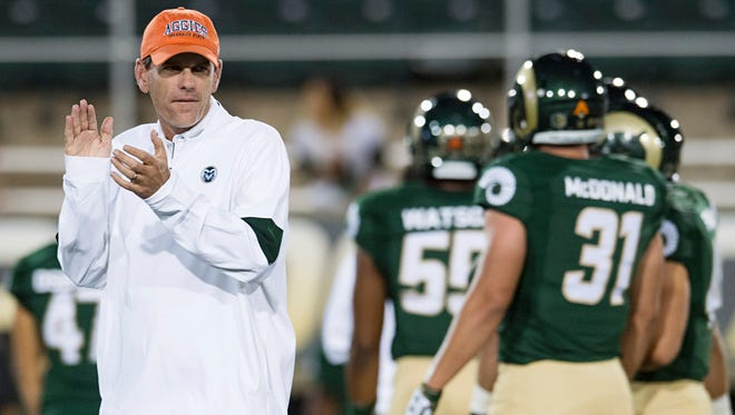 CSU coach Mike Bobo watches his team warm up before an Oct. 1 game against Wyoming at Hughes Stadium. Bobo, a former Georgia offensive coordinator, went against Fresno State defensive coordinator Lorenzo Ward regularly during Ward's six seasons at South Carolina.