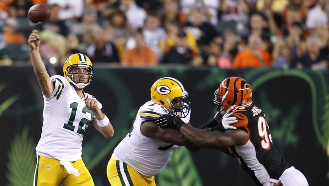 Thursday, Aug. 23, 2012  BENGALS SPORTS : Green Bay Packers quarterback Aaron Rodgers (12) gets off a pass against the Cincinnati Bengals during their game at Paul Brown Stadium.  The Enquirer/Jeff Swinger