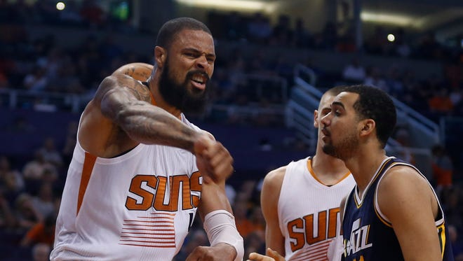 Suns' Tyson Chandler reacts after scoring a basket and drawing a foul against the Jazz at Talking Stick Resort Arena in Phoenix, Ariz. on Sunday, April 3, 2016.