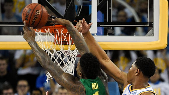 Feb 9, 2017; Los Angeles, CA, USA; Oregon Ducks forward Jordan Bell (1) is unable to make a shot defended by UCLA Bruins forward Ike Anigbogu (13) during the second half at Pauley Pavilion. The UCLA Bruins won 82-79. Mandatory Credit: Kelvin Kuo-USA TODAY Sports
