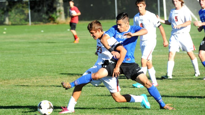 Coshocton's Sam Magness battles for possession with Zanesville's Brandon Nguyen, right, during East Central Ohio League soccer last fall.