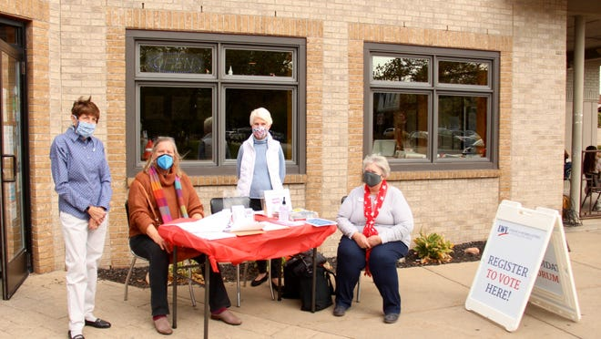 Volunteers from the League of Women Voters Holland Area were at Lemonjello's in downtown Holland, as well as several other locations in the greater Holland area, Tuesday, Sept. 22, for National Voter Registration Day. Volunteers were asking those passing by if they had registered to vote in the November election.