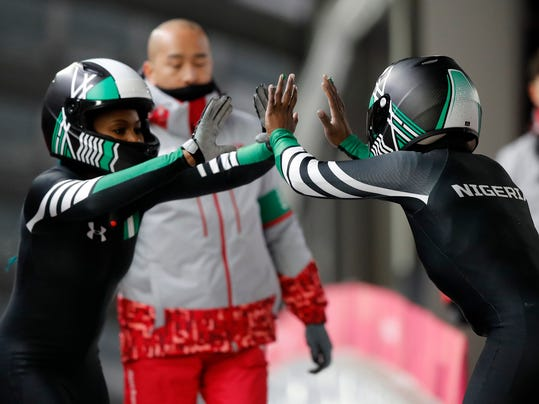Driver Seun Adigun, right, and Akuoma Omeoga of Nigeria finish their second heat during the women's two-man bobsled competition at the 2018 Winter Olympics in Pyeongchang, South Korea, Tuesday, Feb. 20, 2018. (AP Photo/Andy Wong)