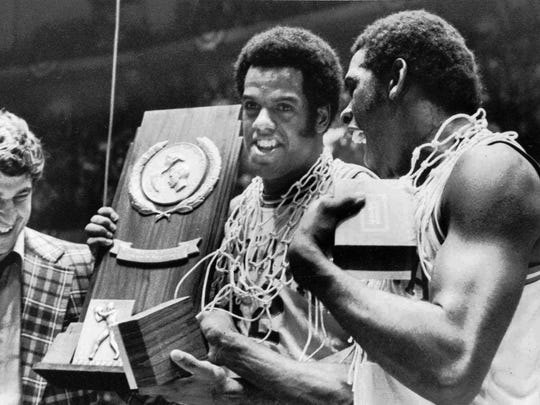 Scott May center and Quinn Buckner are all smiles as they hold the trophy for winning the NCAA Basketball championship in Philadelphia in this March 30 1976 photo.
