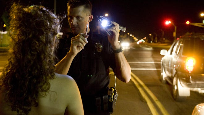 A Phoenix police officer conducts a field sobriety test for DUI.