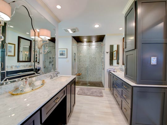 The dreamy master bath is done in today's designer colors.