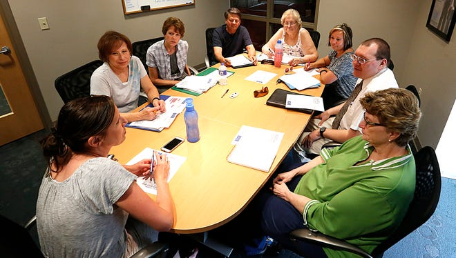 The Back to School FDL leadership team discusses the upcoming event on July 11, 2017. From left to right are Karissa Schneider, Louann Fauska, Gloria Schmidt, Steve Zeigler, Pearl Mertens, Deb Tauer, Scott Richter and Marsha Lemmenes.