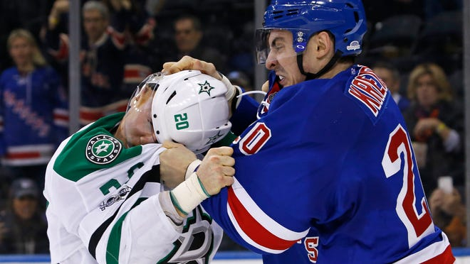 Jan 17, 2017; New York, NY, USA; New York Rangers left wing Chris Kreider (20) fights with Dallas Stars center Cody Eakin (20) during the second period at Madison Square Garden. Mandatory Credit: Adam Hunger-USA TODAY Sports ORG XMIT: USATSI-272860 ORIG FILE ID:  20170117_arh_sh4_0019.jpg