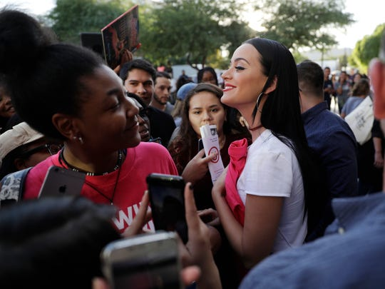 "In this October 2016 file photo, Katy Perry meets with supporters at a rally in support of Hillary Clinton, in Las Vegas. Hollywood will be turning out in force for the women's march on Washington set to follow Donald Trump's inauguration. Actress America Ferrera will chair the march's ""artist table,"" organizers said Monday, Jan. 9, 2017.  Other notables who plan to participate include, Amy Schumer, Scarlett Johansson, Cher, Julianne Moore and Frances McDormand. (AP Photo/John Locher, File)"