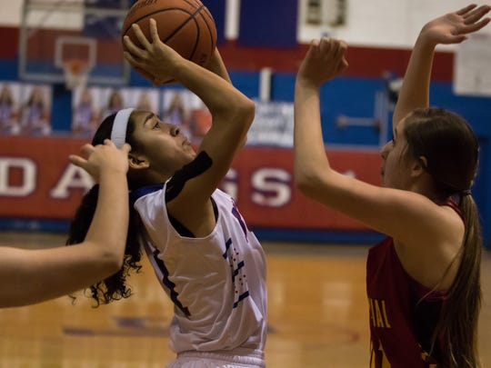 Las Cruces High's Brooke Salmon puts up a shot inside against Centennial at LCHS on Friday.