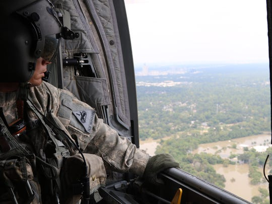 Sgt. 1st Class Aaron Potter, of Sacramento, Calif., serves as a flight engineer with the 2nd Battalion, 501st Aviation Regiment. Potter observed flooding caused by Hurricane Harvey as his crew delivered more than 24,000 bottles of water from the Federal Emergency Management Agency to those still lacking clean water on Sept. 3.