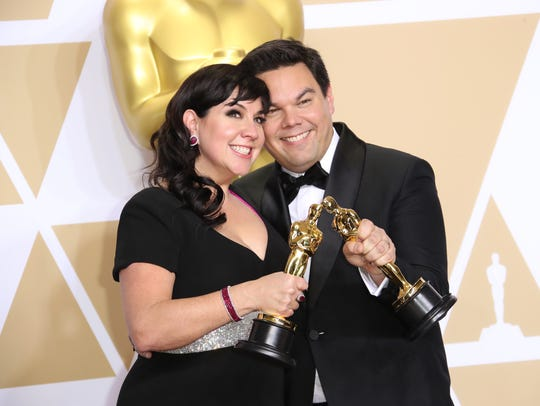 Kristen Anderson-Lopez and Robert Lopez pose with their